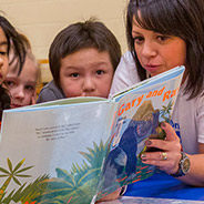 Chevron employee reading to children at Calgary Reads event