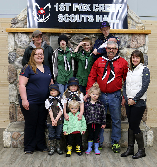 Chevron representative Jennifer Wierzbicki (far right) with members of the 1st Fox Creek Scouts. Chevron's donation helped the troop renovate the Scouts Hall.