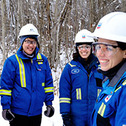 Smiling Chevron employees in winter clothes